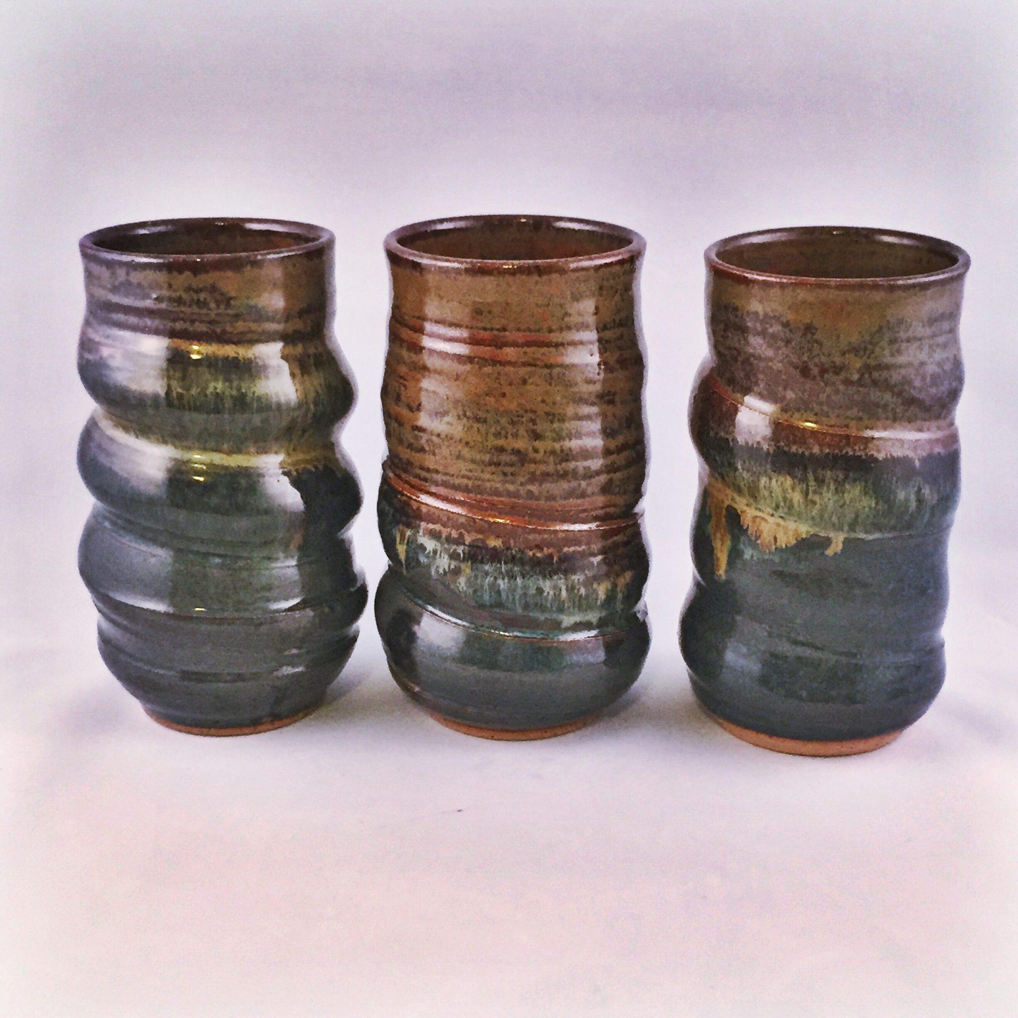 three earthy cups